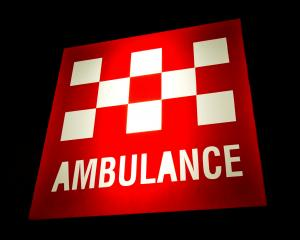 Australian Ambulance sign illuminated at night. Photo: Getty Images