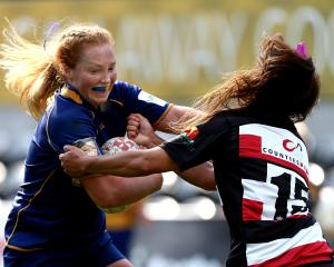 Trisha Hopcroft, of Otago Spirit, fends off Waikohika Flesher, of Counties-Manukau, during a...