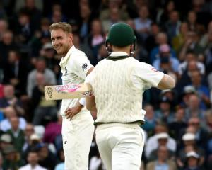 England's Stuart Broad (left) and Australia's David Warner during the third Ashes match at...