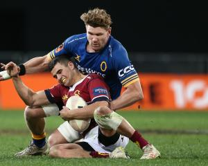 Veteran loose forward Adam Thomson makes a tackle during Otago's successful defence of the...