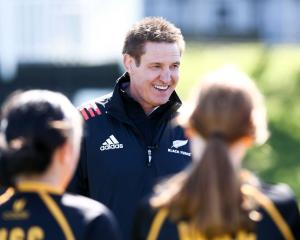 Black Ferns coach Glenn Moore speaks to members of the Wellington Girls' College team during...