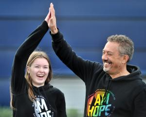 I Am Hope ambassadors Hailey Smith and Mike King prepare for a speech to Queen's High School...