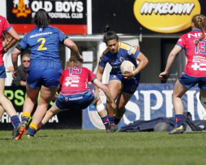 Otago Spirit midfielder Kilisitina Moata'ane runs at Tasman defender Bethan Manners during their...