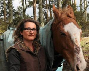 Ingrid Wilkinson with Molly, who was lucky to escape with just a gash to her nose and minor cuts...