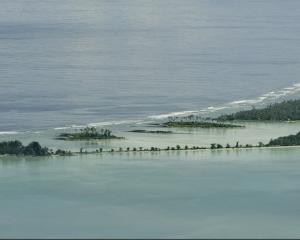 People living in low-lying Kiribati (pictured), Tuvalu and the Marshall Islands are among the...