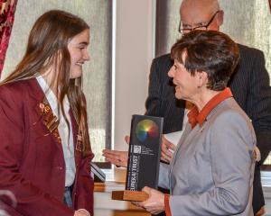 Lila Madden is congratulated for winning the 2019 Sir Paul Callaghan Eureka Premier Award by the...