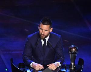 Lionel Messi speaks after winning the Best FIFA Men's player award in Milan. Photo: Reuters