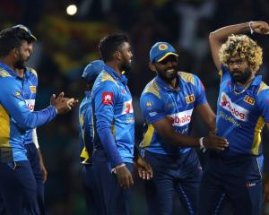 Lasith Malinga of Sri Lanka celebrates with team mates he after takes wicket of Ross Taylor...