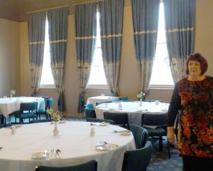 Oamaru Licensing Trust general manager Cathy Maaka walks through the Brydone Hotel's dining room,...