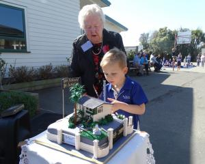 Former Weston School pupil Joan Martin (90) and pupil Hugh Newton (5) cut a cake at the school's...