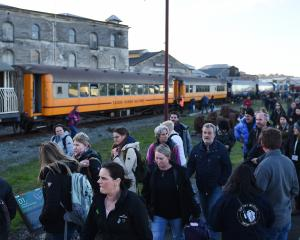 Tenth International Penguin Conference delegates depart from a Dunedin Railways train at Oamaru...