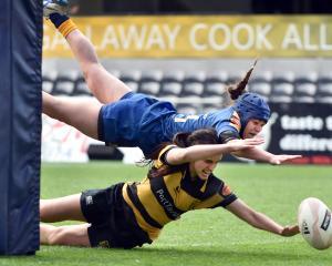 Otago Spirit winger Kiana Wereta (top) beats Taranaki Whio fullback Alesha Williams to score a...