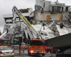 Firefighters at the PGC building, February 22, 2011 Earthquake.  PHOTO: GEOFF SLOAN