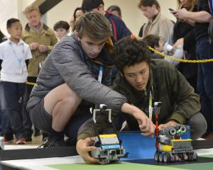 Queenstown Robo Stormers Club members and Wakatipu High School pupils Jasper Cusiel (left) and...