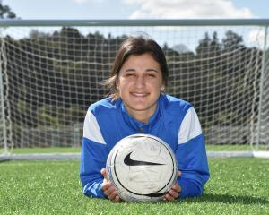 Rose Morton (19) relaxes at the Logan Park Turf yesterday as she prepares for Southern United's...