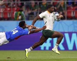 South Africa's Warrick Gelant in action with Namibia's Chad Plato. Photo: Reuters