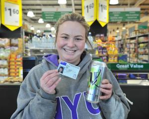 Sarah Wouters (26), with ID in hand yesterday, in case she is asked for it at Countdown Dunedin...