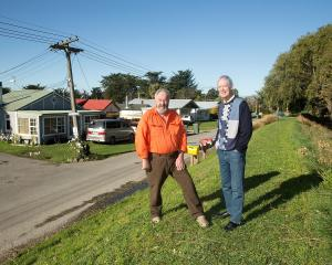 Upper Selwyn Huts residents Graeme Young and Graham Evans are angry at the district council's...