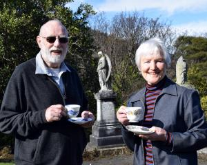 Heritage Roses Otago committee member Rex Thomson and Southern Heritage Trust trustee Ann Barsby...