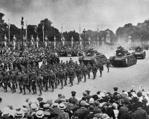 The Tank Corps march during the Victory celebrations on Peace Day in London. - Otago Witness, 30...