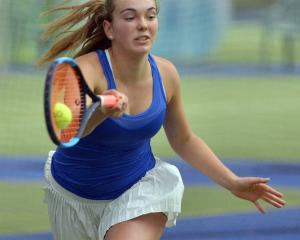 St Margaret's College 15-year-old Abby Mason plays a forehand during the final of the Otago...