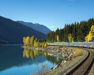 A VIA Rail passenger train along Moose Lake in Jasper National Park, Alberta, Canada. PHOTOS: TNS