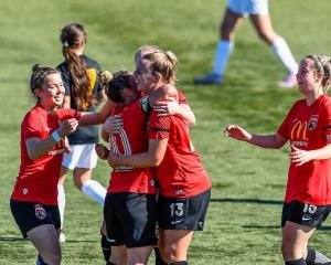 The Pride celebrate a goal from Whitney Hepburn (13) against Capital on Sunday.