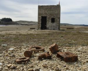 Remains of an old water tower and killing shed. PHOTOS: GERARD BRIEN/HISTORIC PICS: SUPPLIED/ODT...