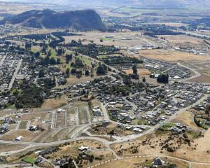 The Wanaka Golf Club sits in the centre of this aerial photograph of the town. PHOTO: STEPHEN...