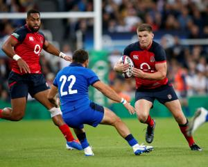England's Owen Farrell in action with Italy's Guglielmo Palazzani Action Photo: Images via Reuters