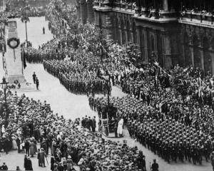Looking down Whitehall, London, as American troops pass the memorial to the fallen during the...