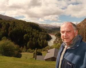 Concerned ratepayer Tom Dery opposite a proposed hillside subdivision above the Shotover River....