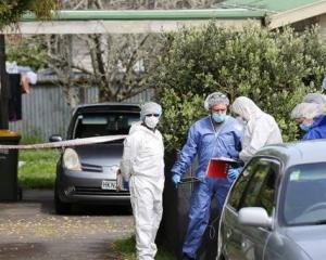 The property was cordoned off as forensic investigators examined the scene. Photo: NZ Herald