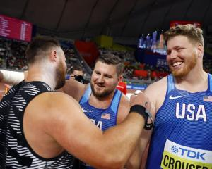 Joe Kovacs (R) celebrates winning gold with Ryan Crouser (silver, R) and New Zealand's Tom Walsh....