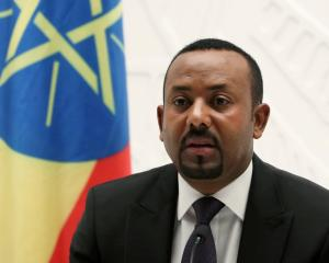 Ethiopia's Prime Minister Abiy Ahmed speaks at a news conference at his office in Addis Ababa....