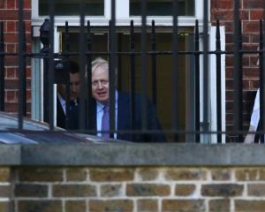 UK Prime Minister Boris Johnson is seen leaving Downing St following Brexit negotiations. Photo:...