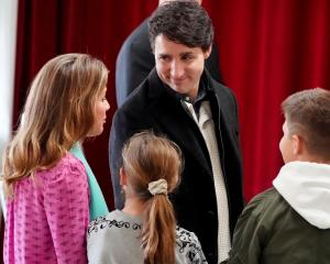Justin Trudeau arrives with his family to cast his vote in the Papineau area of Montreal, Quebec....