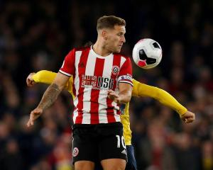 Sheffield United's Billy Sharp in action against Arsenal. Photo: Reuters
