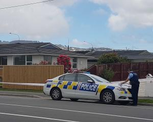 Police taped off three houses and a footpath in St Martins after a stabbing on Wednesday. Photo:...