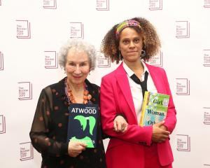 Margaret Atwood poses with Bernardine Evaristo after jointly winning the Booker Prize in London...