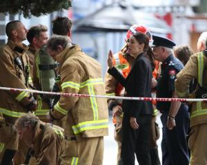 Prime Minister Jacinda Ardern meets firefighters at the scene of the SkyCity fire. Photo: NZ Herald