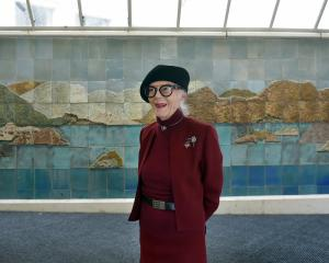 Aesthetic co-ordinator Barbara Brinsley stands in front of a Neil Grant ceramic, one of the...