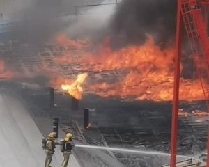 Firefighters can be seen bravely tackling the flames on the SkyCity Convention Centre. Photo:...
