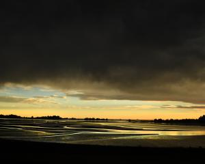 Rain clouds threaten above Blueskin Bay, north of Dunedin. PHOTO: STEPHEN JAQUIERY