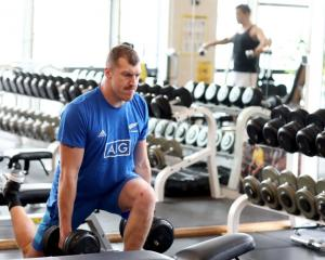 Brodie Retallick trains in the gym ahead of the All Blacks semifinal clash with England. Photo:...