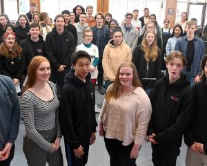 Southern singers (from left) Ronan Geraghty (17), of Logan Park High School, Rosie Auchinvole (16...