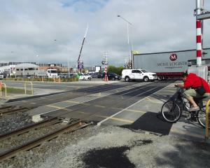 Carmen Rd's railway crossing will receive pedestrian gates to make the area safer.