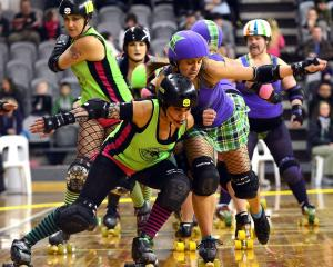 2013/Sirens of Smash All stars number 4 Natasha Howe left and Gallow Lasses number 75 Kat Geeves during the Triple Be Header Dunedin Roller Derby competition at the Lion Foundation Arena on Saturday Night.PHOTO PETER MCINTOSH