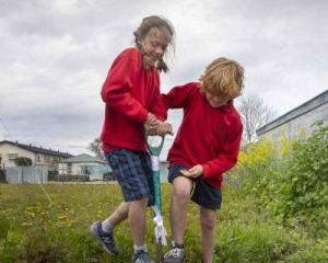 St Albans School students Georgetta Haller, 10, and Joe McInerney-Boon, 10, turn the first sod at...
