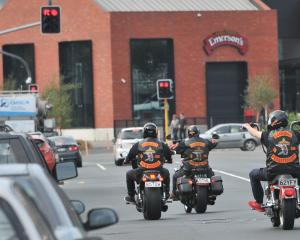 Bikers wearing gang patches ride through Dunedin.PHOTO: ODT FILES